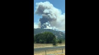 Huge plumes of smoke from Mendocino Complex fires seen from freeway