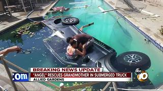 """""""Angel"""" rescues grandmother in submerged truck"""