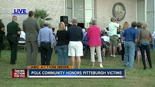 Local community honors victims - Video