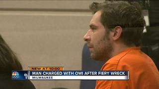 Suspect charged with an OWI after fiery crash - Video