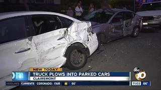 Truck plows into parked cars - Video