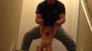Dad Plays With His Toddler Making Martial Arts Sounds - Video