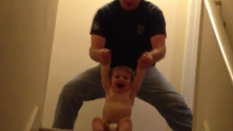 Dad Plays With His Toddler Making Martial Arts Sounds