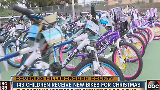 143 children receive new bikes for Christmas - Video