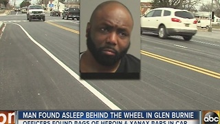 Man found asleep in his car with 24 baggies of heroin - Video