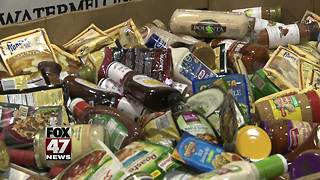 Local businesses collect food donations for those in need - Video