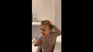 My son brushing his teeth