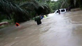 Hero Thai cave rescuer has to be saved after getting stranded in flood waters - Video