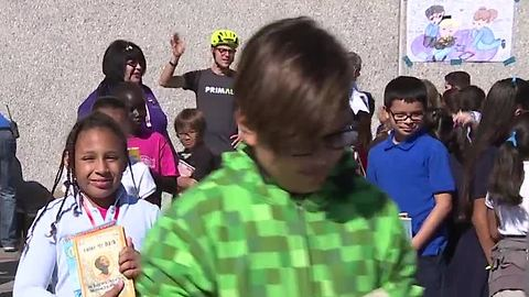 Las Vegas elementary school students receive more than 1,000 books on bikes