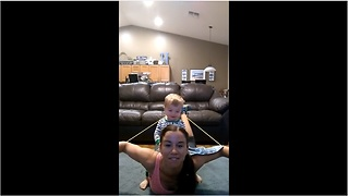 Baby crashes mom's pliates home workout - Video