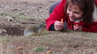 Gopher kisses woman for tasty carrot