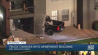 Truck crashes into apartment building