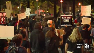 People march through Downtown Baltimore protesting police violence against Black people