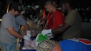 St. Lucie County firefighters prepare turkey dinners for families in need