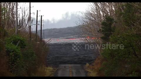 Fast-moving lava flow races downhill from Kilauea's most active fissure
