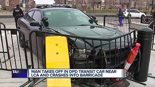 Man takes off in police transit car and crashes into barricade - Video