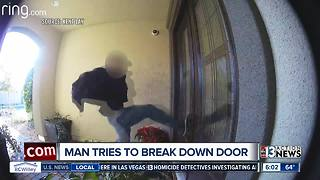 Shocking surveillance shows man hurling himself at a door, trying to break into home - Video