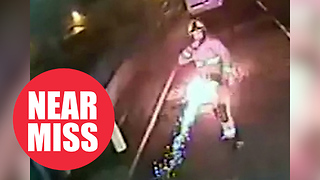 Shocking CCTV shows moment firework misses firefighter by inches after being thrown at him - Video