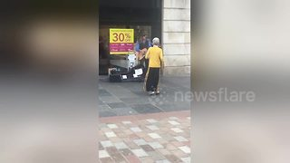 Elderly woman shows she loves to boogie in Glasgow street