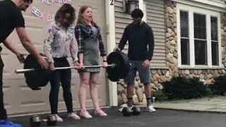 Fitness Hobbyists Perform Weightlifting Gender Reveal - Video