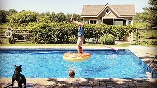 Dad Finds the Coolest Way to Jump Into an Inflatable Ring - Video