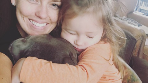 Snuggling pit bull is a cuteness overload