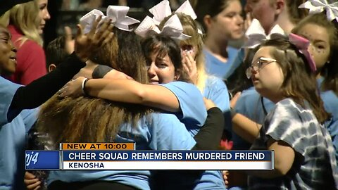 Cheer squad honors murdered friend at football game