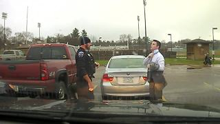 Police officer helps UW-Stout student tie up some loose ends - Video