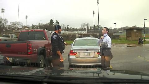 Police officer helps UW-Stout student tie up some loose ends
