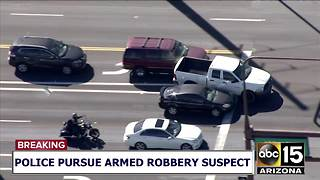 RAW: Pursuit suspect carjacks woman at west Phoenix intersection - Video