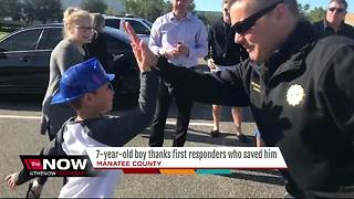 7-year-old boy reunited with paramedics who saved his life - Video