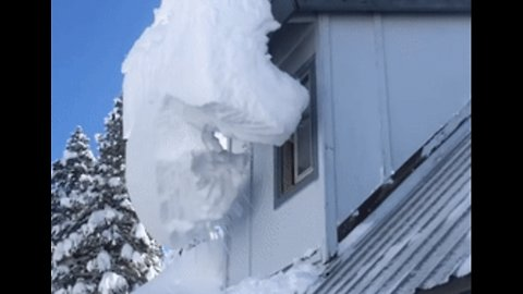 Truckee Residents Clear Snow From Rooftop