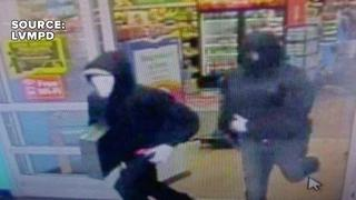 Surveillance photos released in Walmart armed robbery - Video