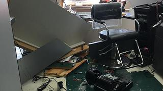 Car plows into Elyria salon during haircuts - Video