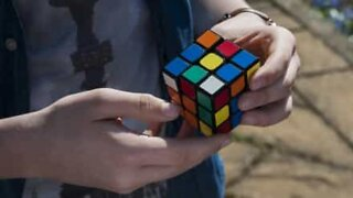 Incredible! Young man uses magic to solve Rubik's Cube