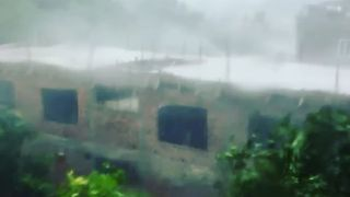 Wind Rips Metal Sheeting off Roofs as Typhoon Doksuri Hits Vietnam - Video
