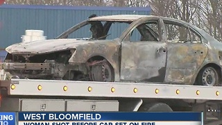 Woman shot before car set on fire - Video