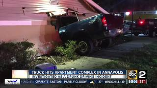 Truck hits apartment complex building in Annapolis