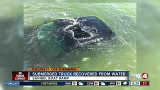 Truck rolls into water at boat ramp