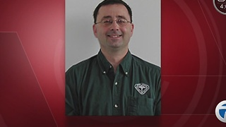USA Gymnastics doctor arrested after alleged sexual assault of a minor in Michigan - Video