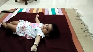 Baby conducts first successful turn over - Video