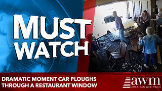 Dramatic moment car ploughs through a restaurant window - Video