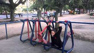 Circus Performer Shows Off Flexibility on Street Gym Machine - Video