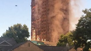 Smoke Billows From London High-Rise Destroyed by Deadly Fire - Video