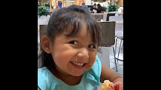 Cute little girl adorably tells us it's delicious