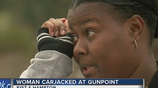 Woman carjacked at gunpoint in Milwaukee - Video