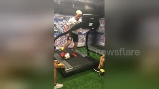 US soccer coach demonstrates amazing dribbling skills on treadmill - Video