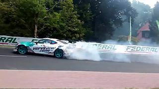 Drifting race car sends tire flying into the crowd - Video
