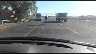 Cyclist Miraculously Avoids Getting Hit by a Truck - Video