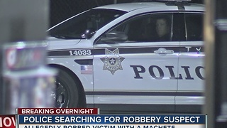 Robbery suspect on the run after helding up a man with a machete - Video